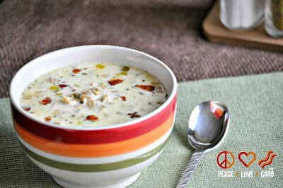 Low Carb Slow Cooker Clam Chowder in striped bowl with spoon.