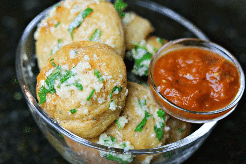 Keto Parmesan Garlic Bread Bites with a small bowl of marinara sauce
