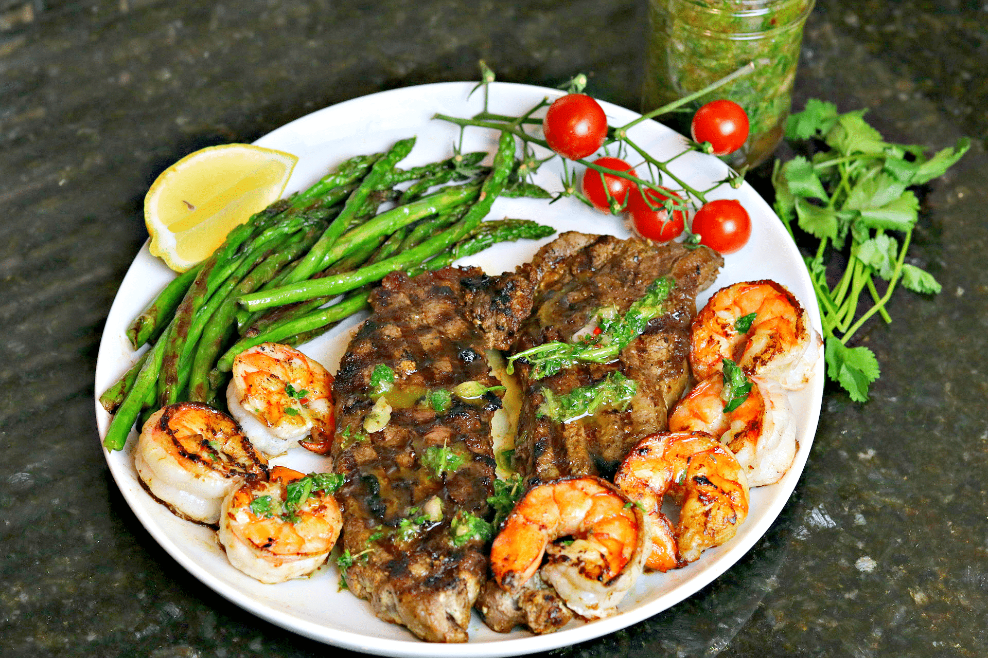 NY Strip Steak with Chimichurri and shrimp on a plate