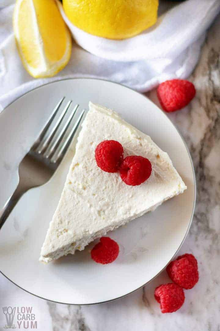 Italian Lemon Ricotta Cheesecake with berries on a white plate