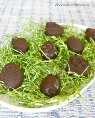 Low carb chocolate Easter treats in a nest of Easter grass on a plate.