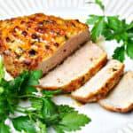 sliced Ninja Foodi air fryer pork chop on a plate