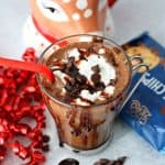 a close up of Peppermint Mocha in a glass mug with Choczero baking chips